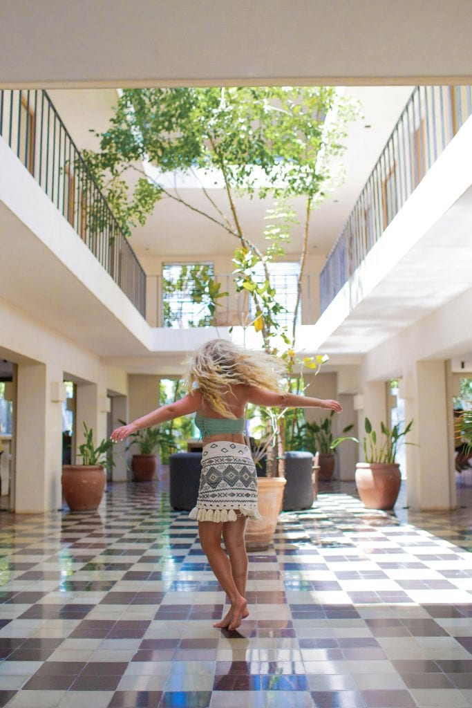 A woman enjoying her boutique hotel experience in Mexico