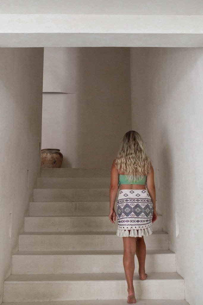 A woman walking up the stairs at Casa Pueblo boutique hotel