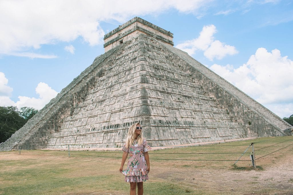 A woman enjoying her boutique tour at Chichen Itza from Tulum