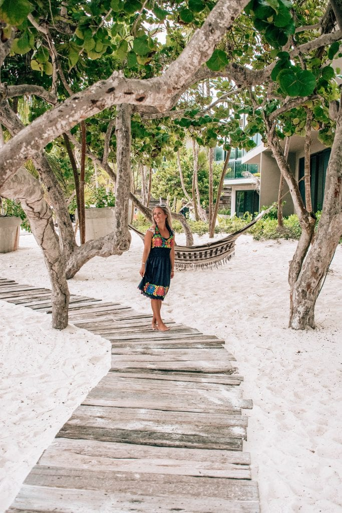 A woman walking around Casa Malca boutique hotel in Tulum