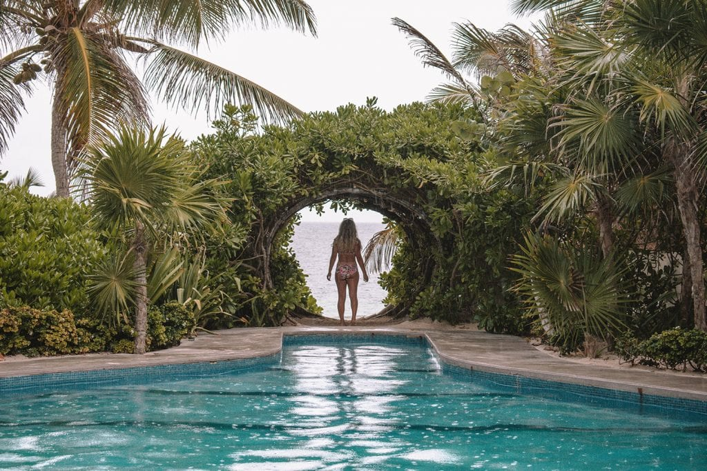 A woman enjoying the pool at Casa Malca boutique hotel in Tulum