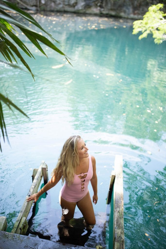 A happy woman in a Mexican cenote