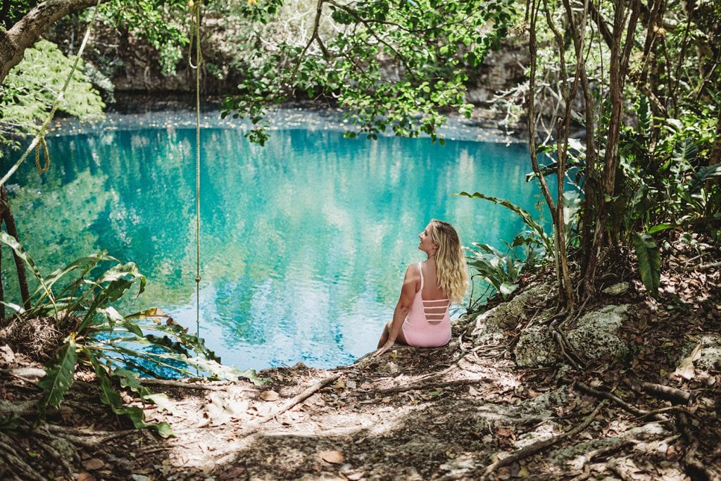 A woman enjoying a beautiful day at a Mexican cenote in Tulum
