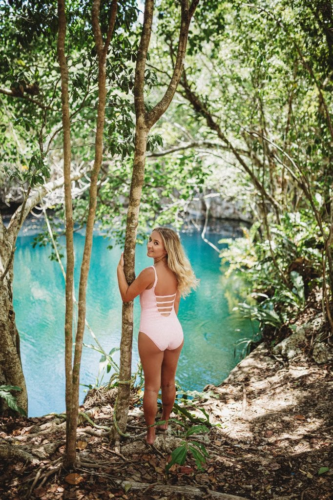 A woman at a cenote in Tulum, Mexico