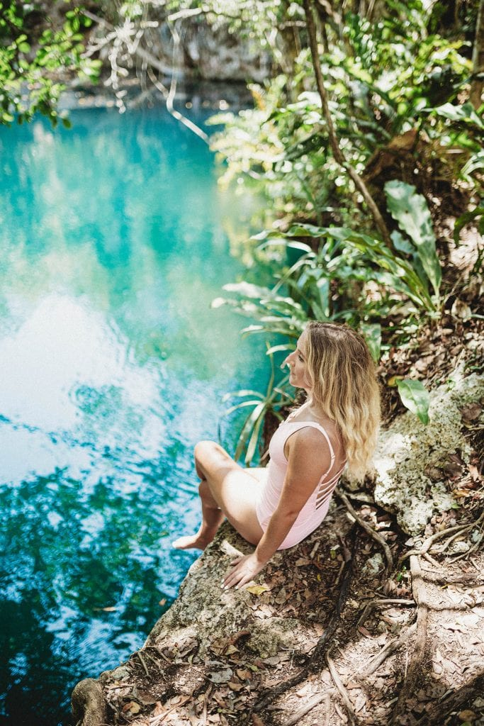 A woman enjoying time at Cenote Angelita in Tulum, Mexico