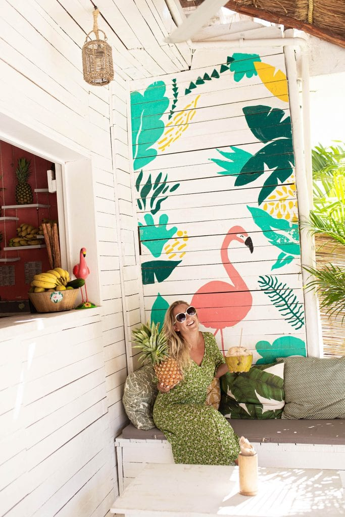 A woman enjoying her boutique travel experience in Tulum, Mexico