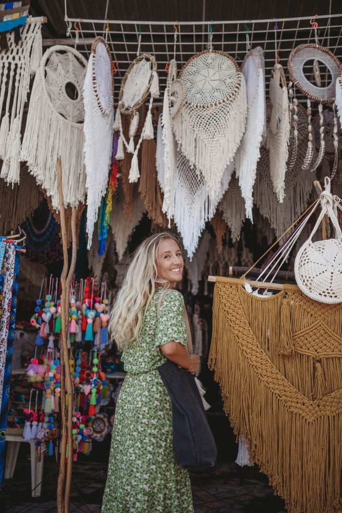A woman having fun boutique shopping in Tulum