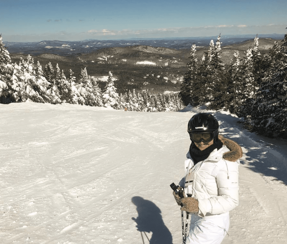 A woman enjoying ski day activities at Mount Snow, Vermont