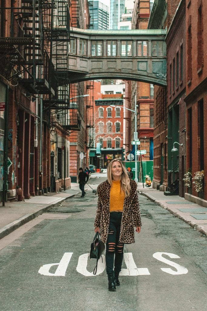 A woman walking through Tribeca in New York City