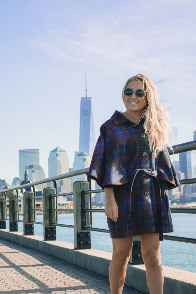 A woman at Liberty State Park that faces New York City