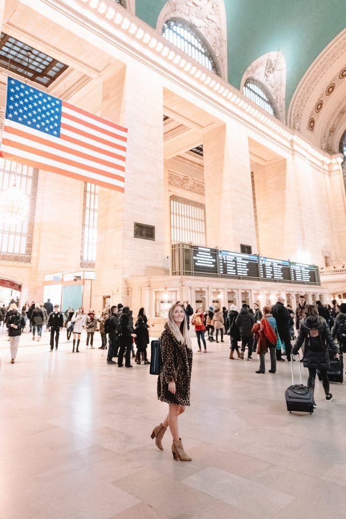 A woman walking through Grand Central Station in New York City