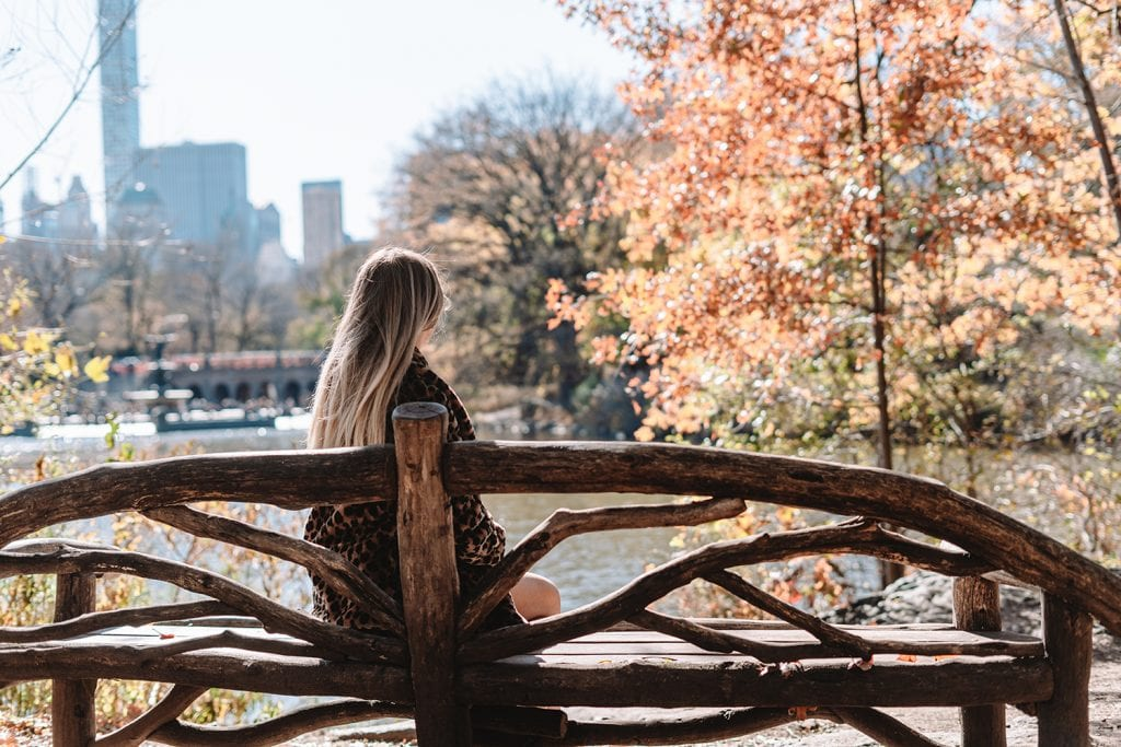 A woman enjoying fall foliage in Central Park