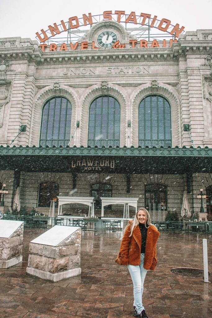 A woman at Union Station in Denver during winter