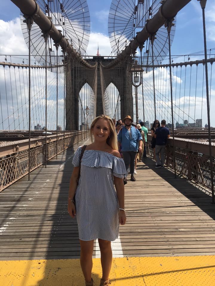 A woman on the Brooklyn Bridge in New York City