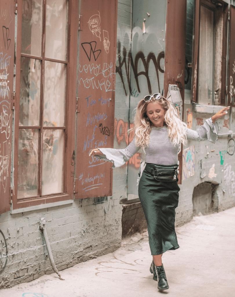 A woman enjoying New York Fashion Week