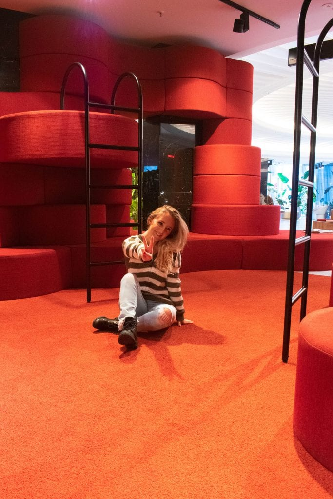 A woman enjoying the fun rooms at 25Hours Hotel in Cologne