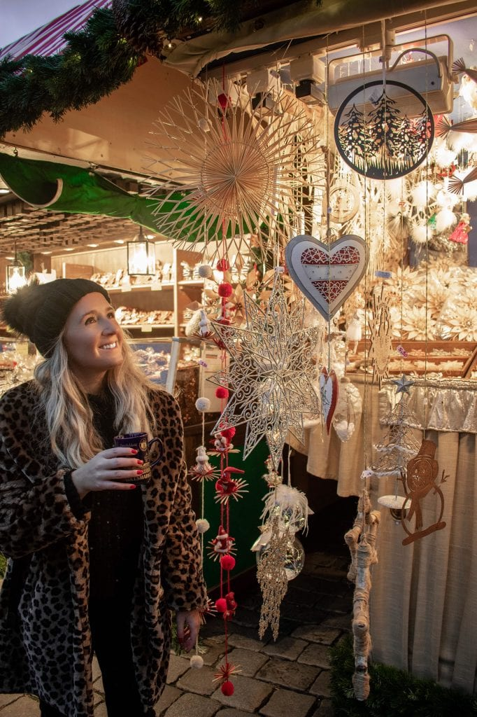 A woman experiencing the magic at a Bavaria Christmas market stall