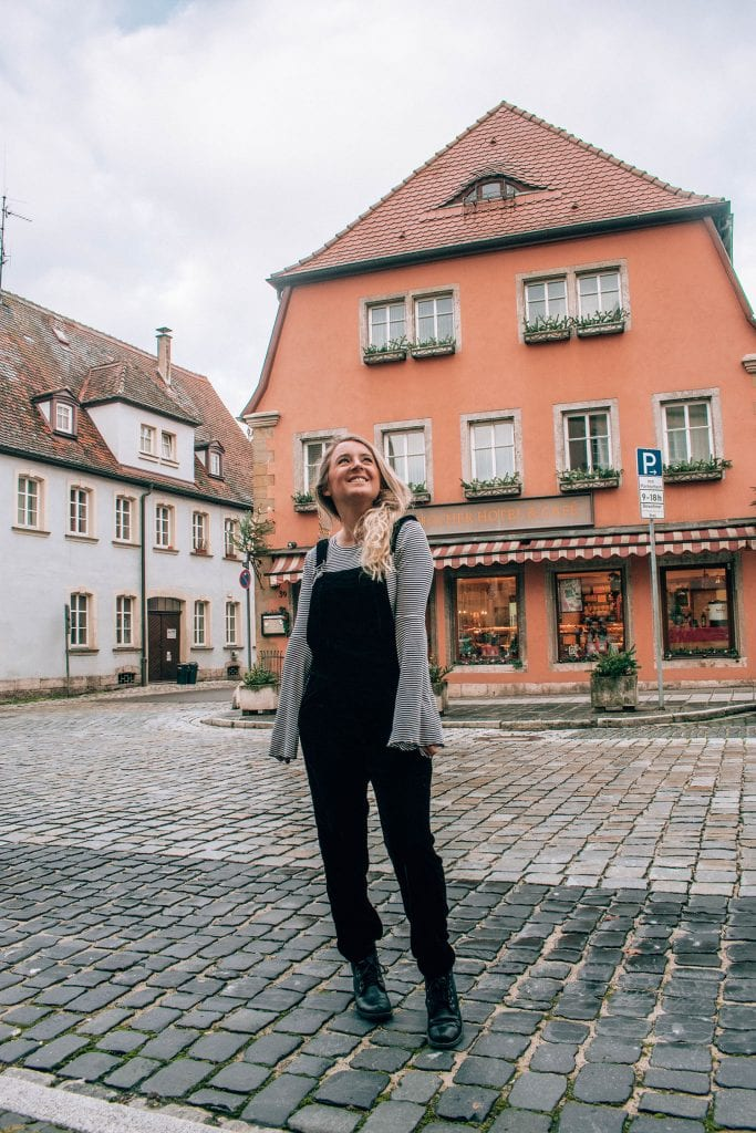 A woman standing in front of Hocher Hotel in Rothenburg, Bavaria