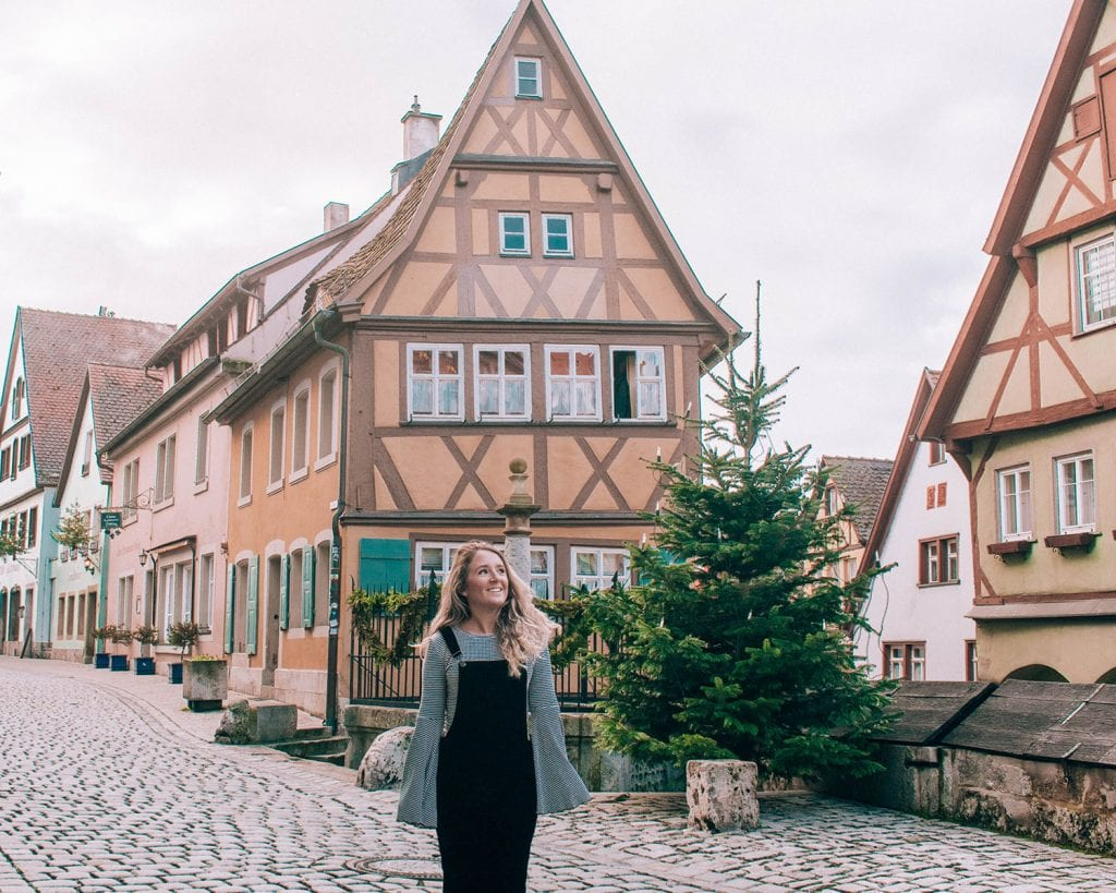 A woman standing in front of the Plonlein in Rothenburg at the Bavaria Christmas Markets