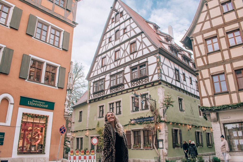 A woman exploring the fairytale city of Rothenburg during the Bavaria Christmas markets