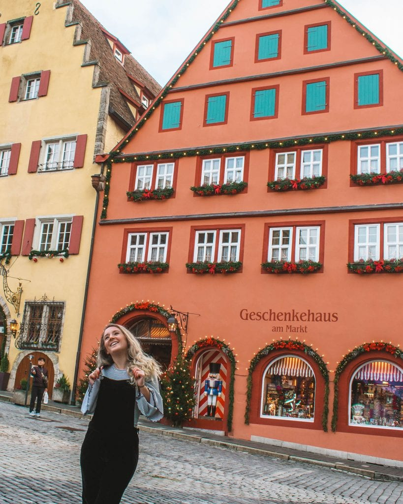 A woman standing in front of a Christmas store in Rothenburg