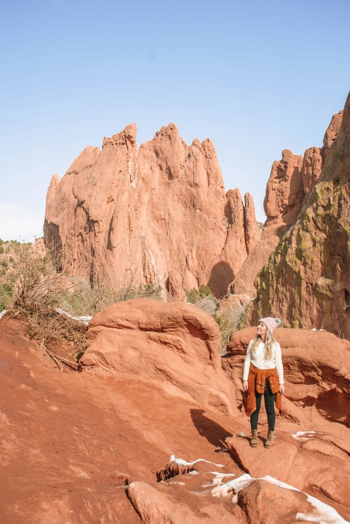 A woman exploring Garden of the Gods in Colorado - one of the best spring break destinations