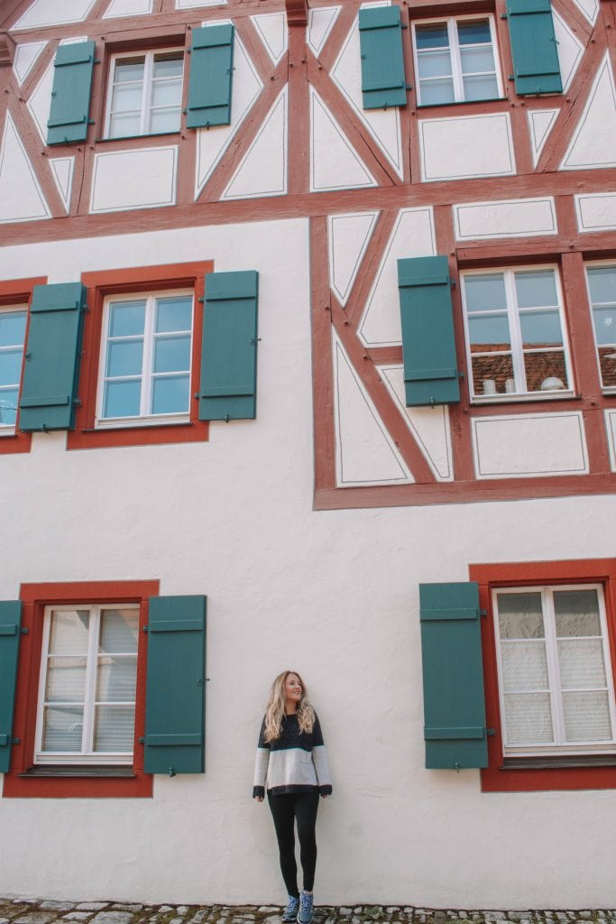 A woman standing in front of a timber home in Rothenburg, Bavaria