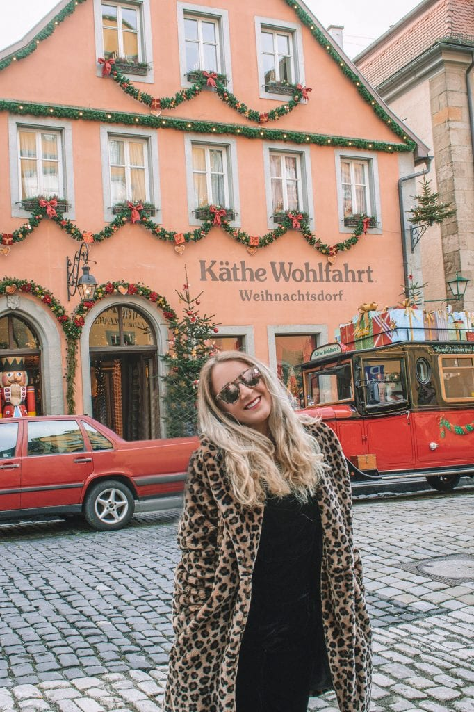 A woman standing in front of Kathe Wohlfahrt at the Bavaria Christmas markets