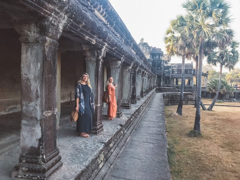 Two women exploring Angkor Wat complex in Cambodia