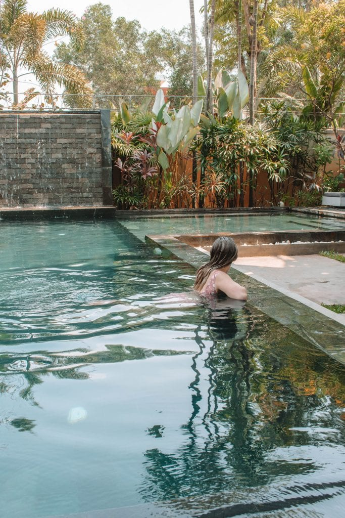 A woman enjoying a pool day in Siem Reap
