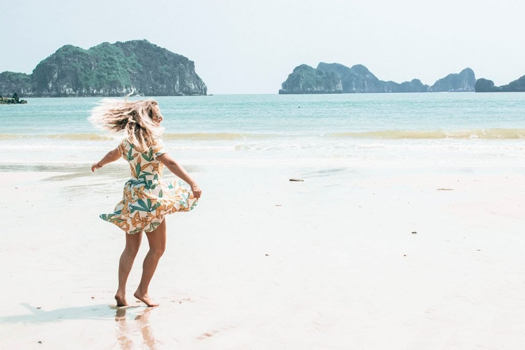 A woman dancing on a beach in Vietnam