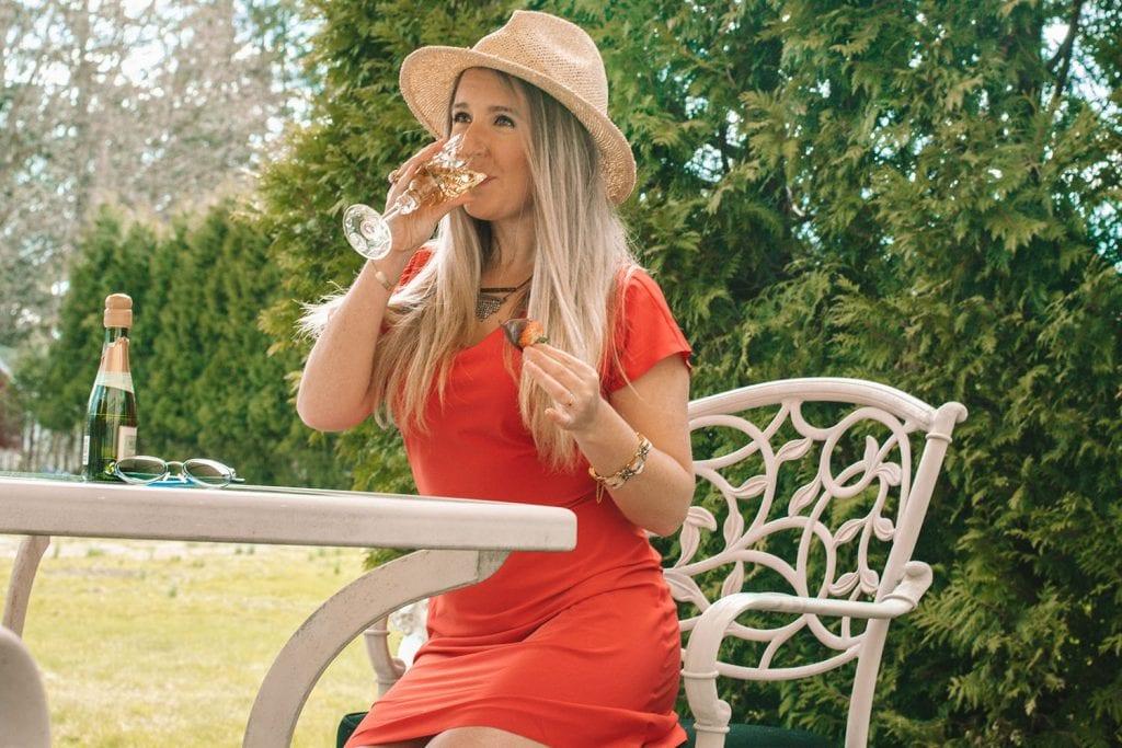 A travel blogger dressing enjoying travel inspiration from home