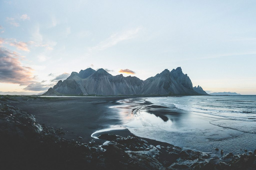 A beautiful mountain on a black sand beach in Iceland