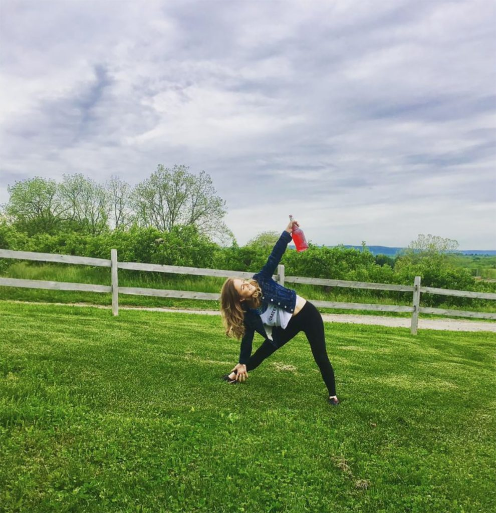 A woman doing yoga at a Hudson Valley cidery