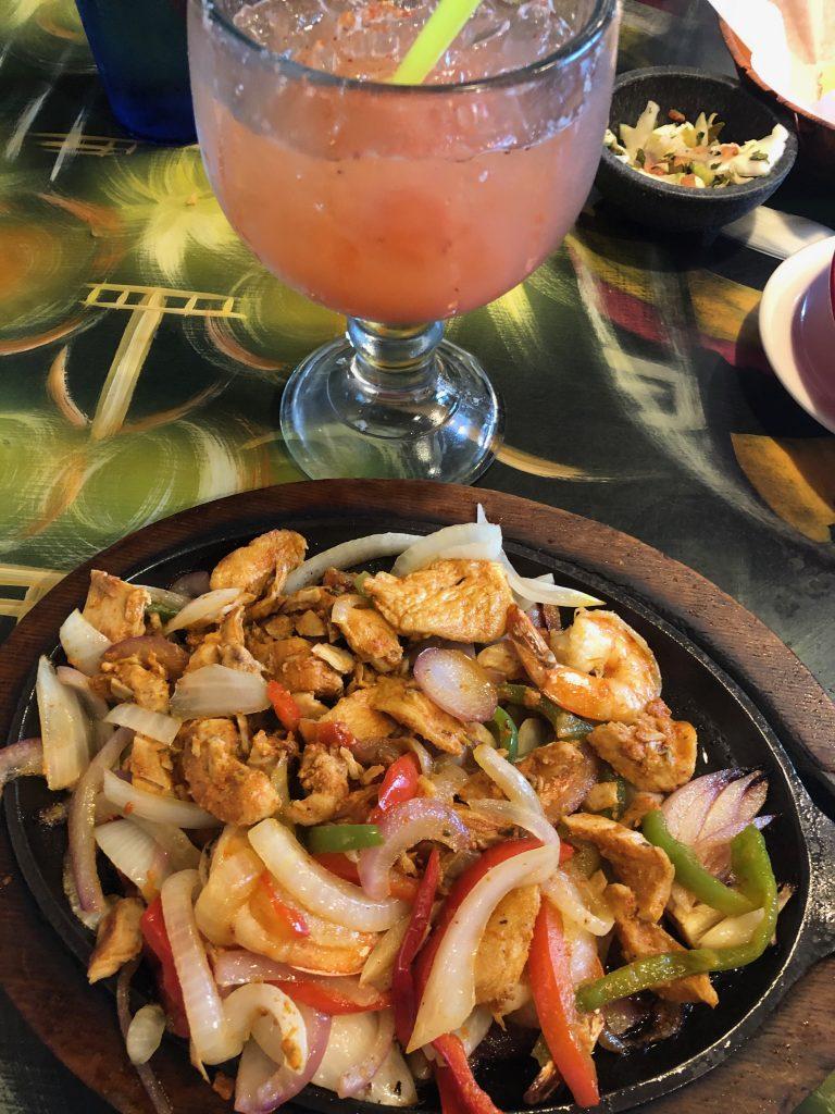 Chicken and shrimp fajitas with a margarita