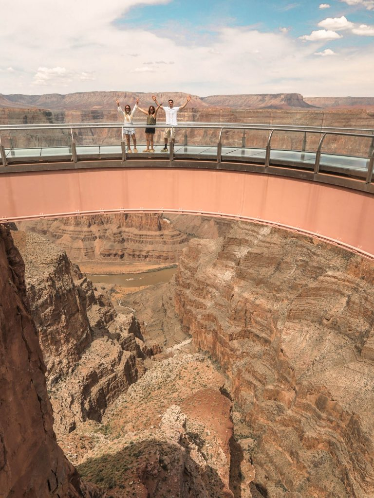 A family having fun on Grand Canyon West's Skywalk