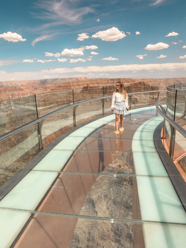 A woman walking on the Grand Canyon West Skywalk