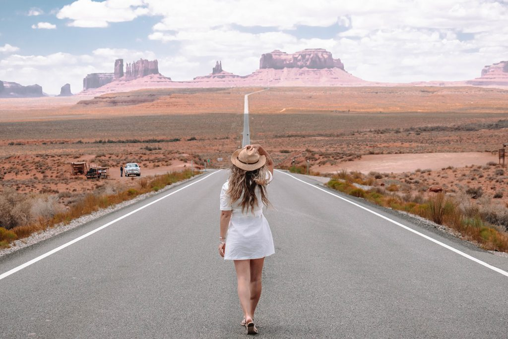 A woman on a road trip in Monument Valley Park