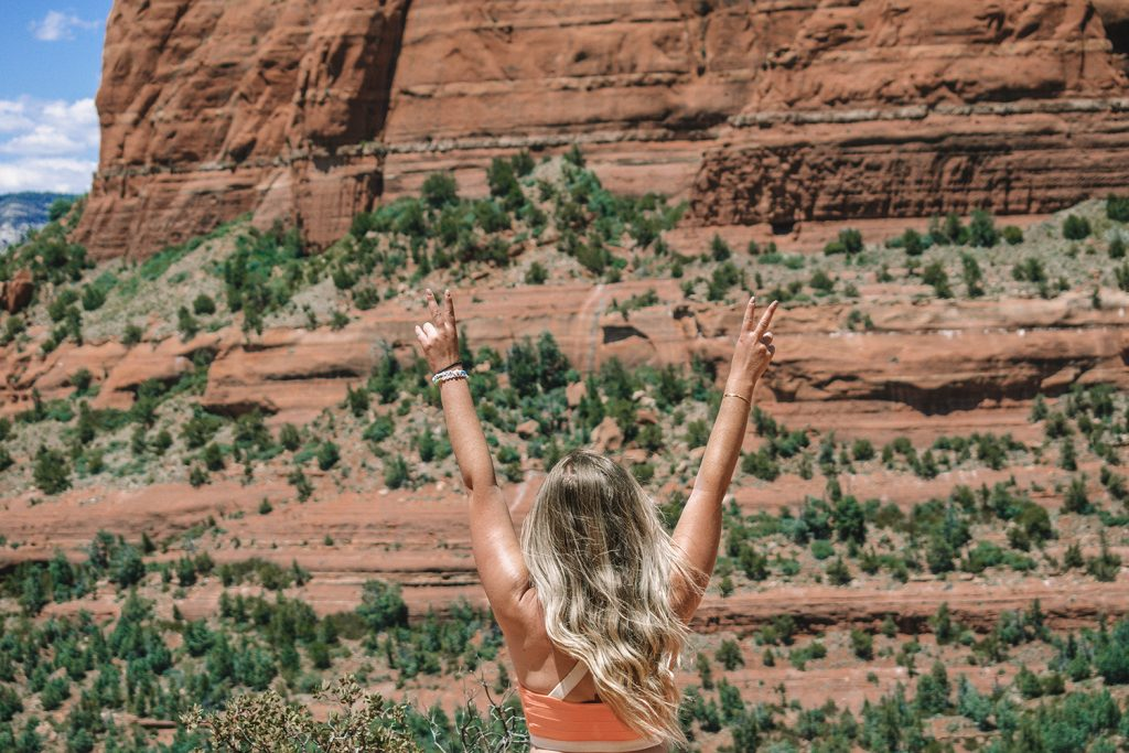 A woman enjoying epic views on hike during a weekend in Sedona