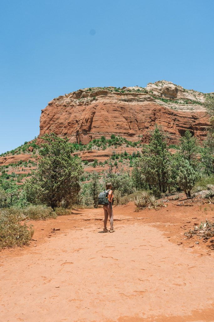 A woman on a hike to Devil's Bridge in Sedona