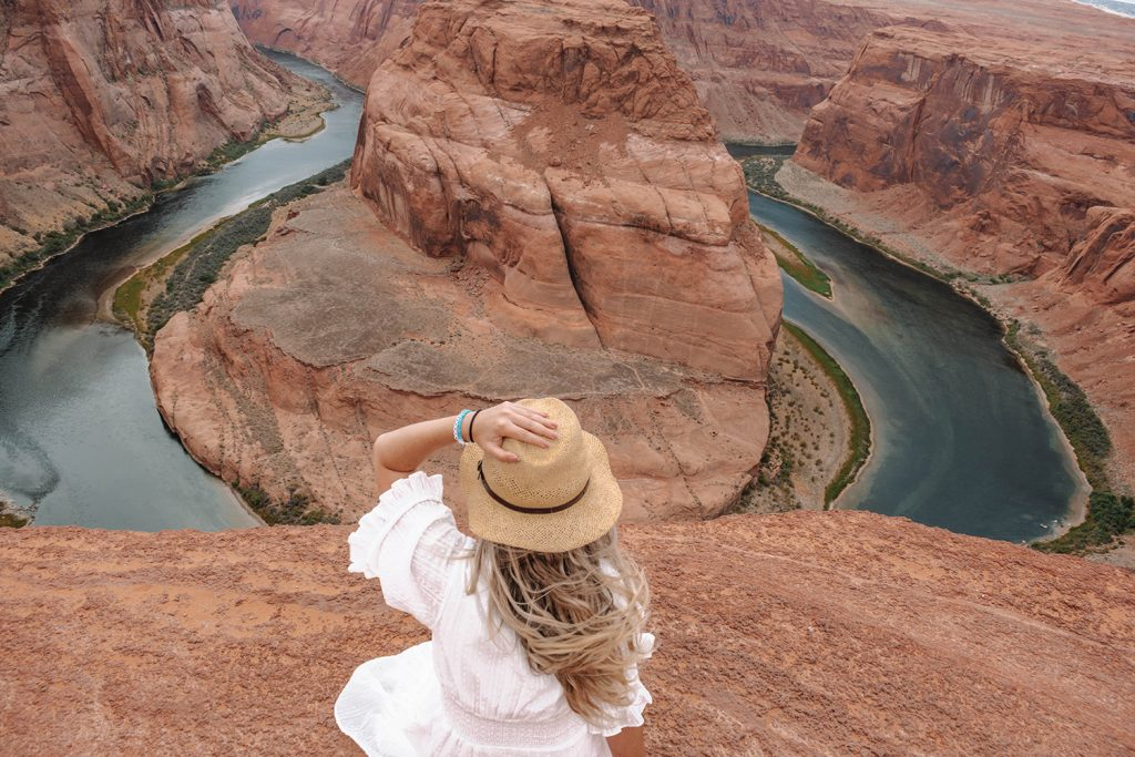 A woman looking at Horseshoe Bend