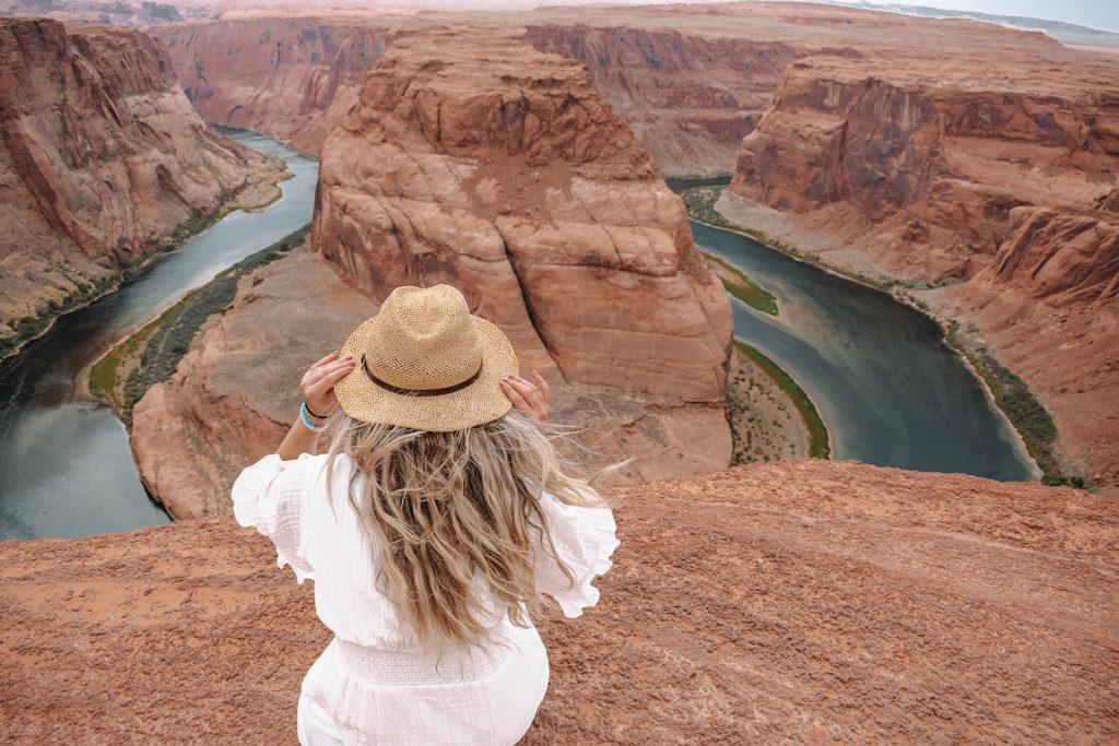 A woman exploring Horseshoe Bend, a natural wonder