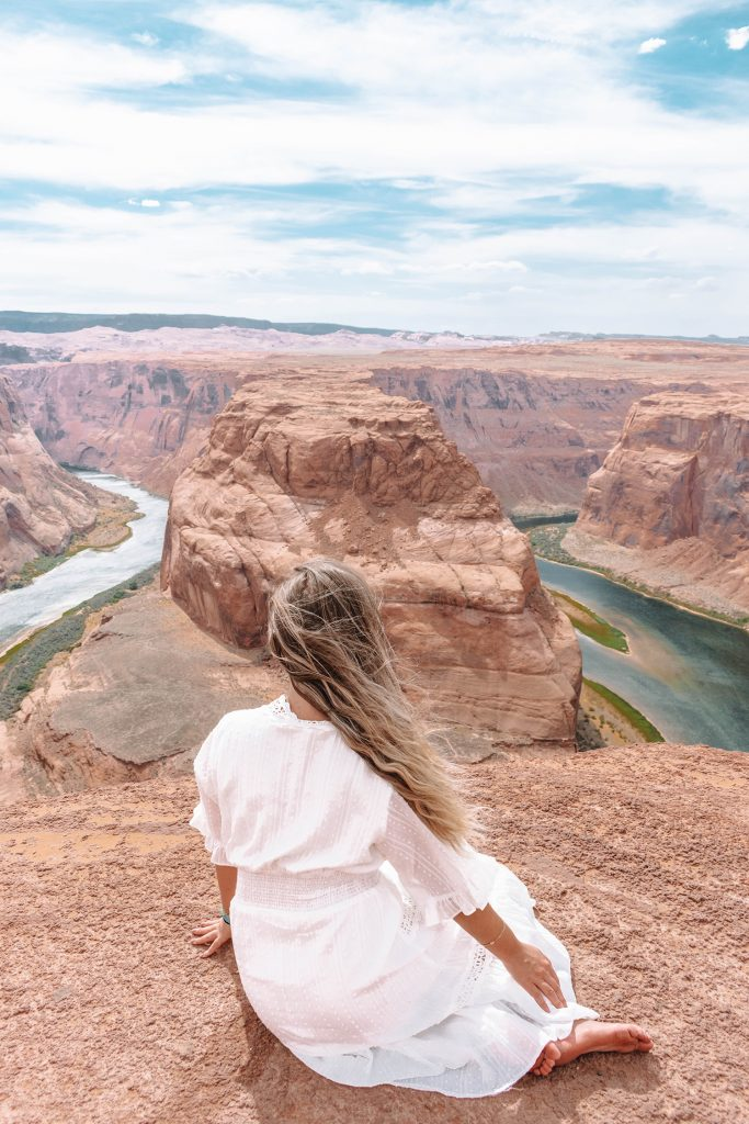 A woman enjoying the views at Horseshoe Bend on a Southwest road trip