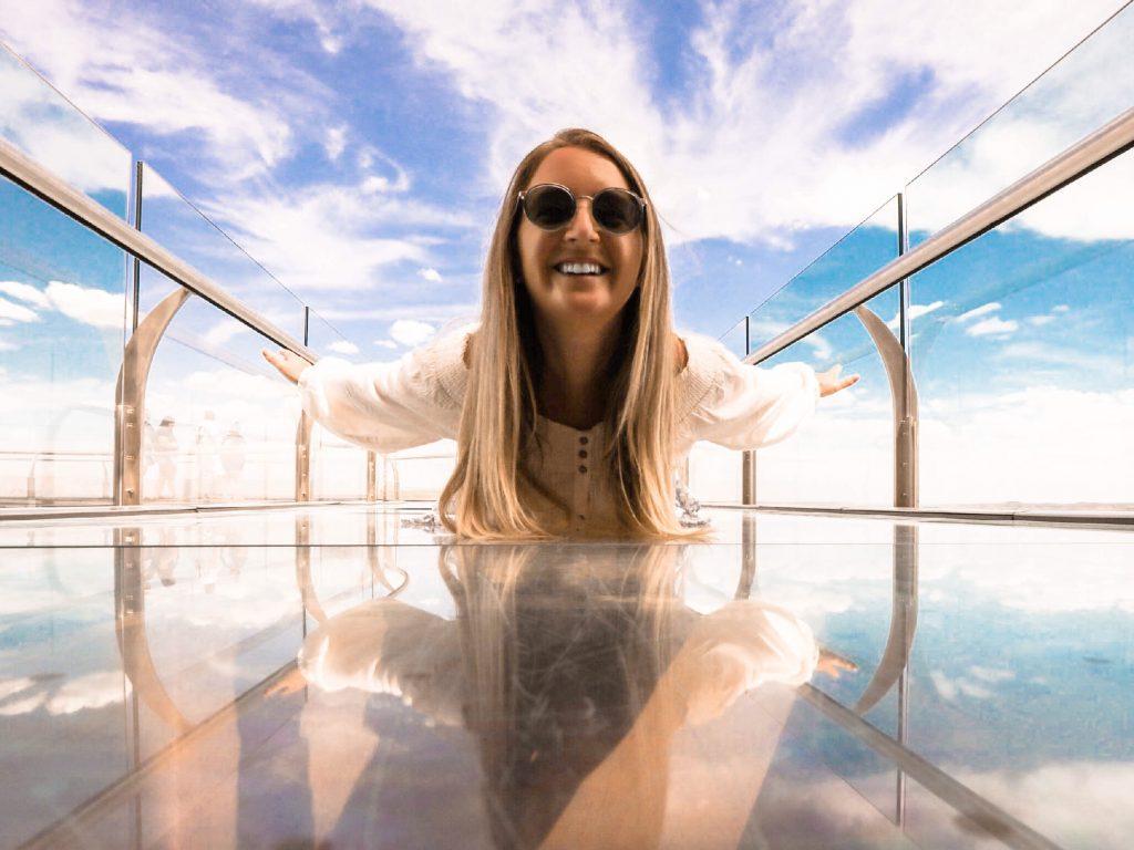 A woman having fun on the Skywalk