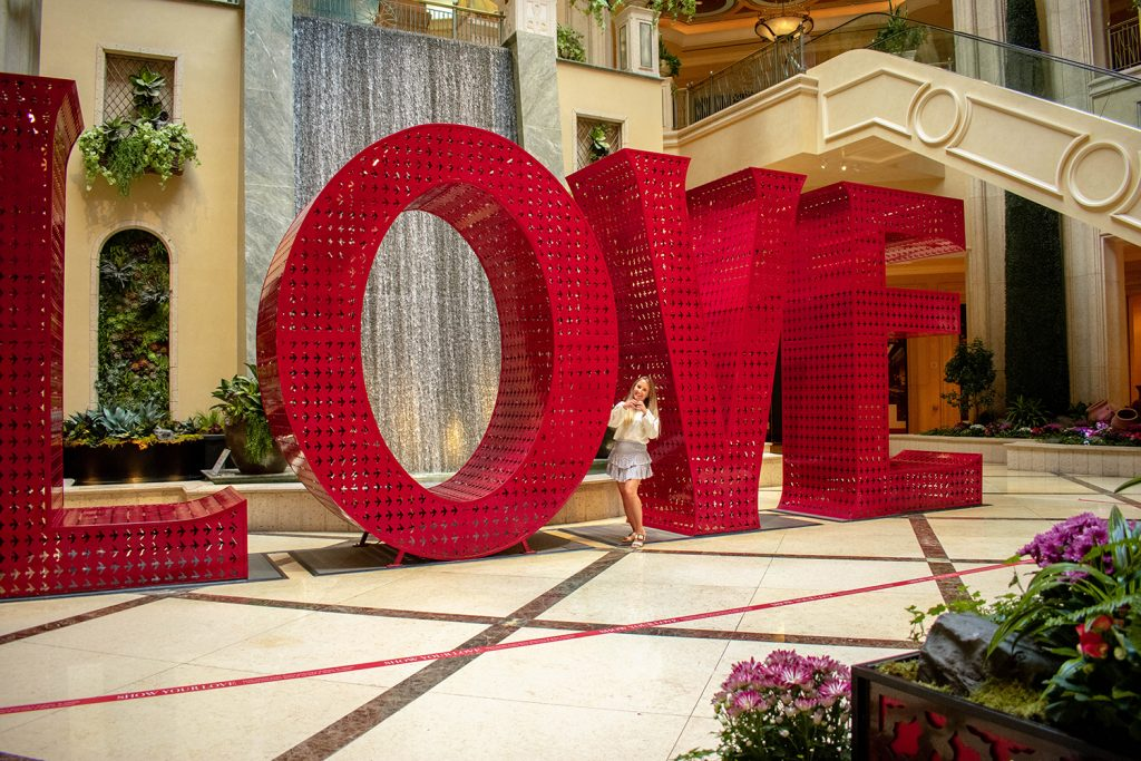 Woman in front of Love display at The Venetian Hotel