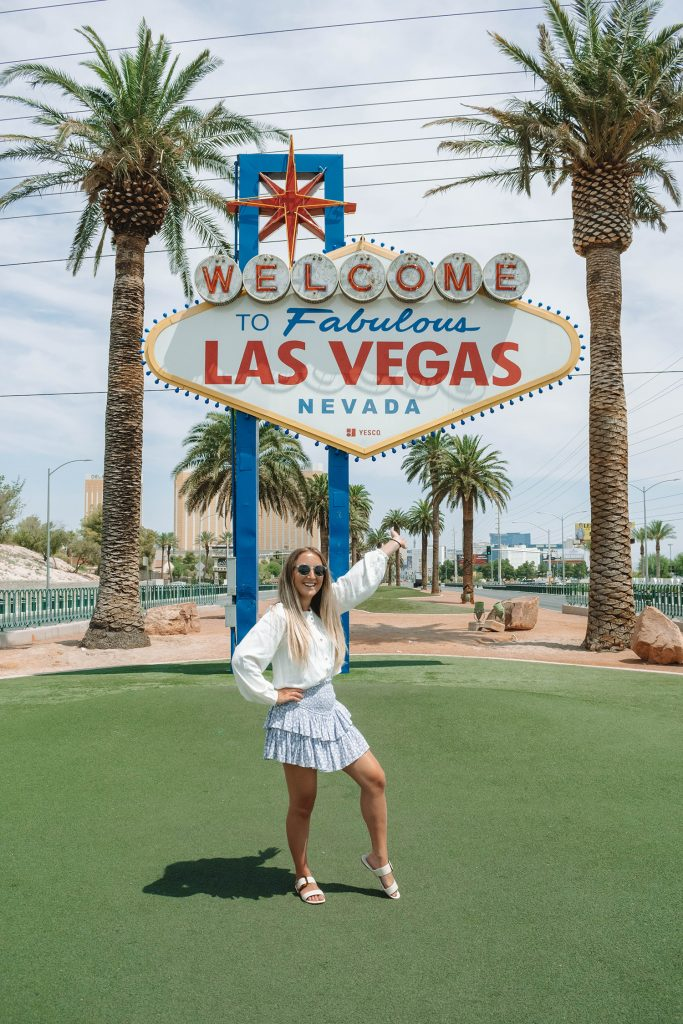 A woman in front of the Welcome to Fabulous Las Vegas Sign