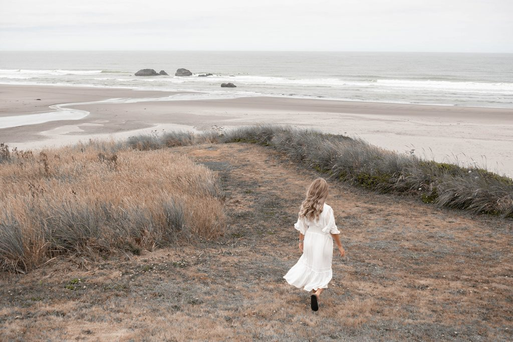 A woman walking Bandon Beach in Oregon