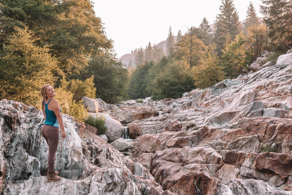 A woman hiking Emerald Pools in Tahoe National Forest