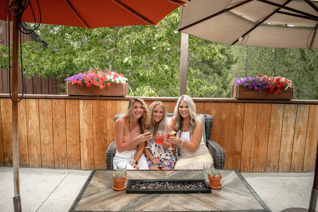 Three women having a drink in Lake Tahoe, California