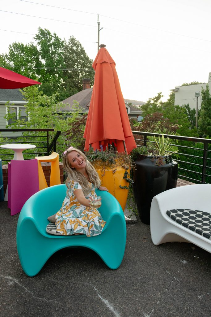 A woman having fun on the rooftop at the Inn at Northrup Station